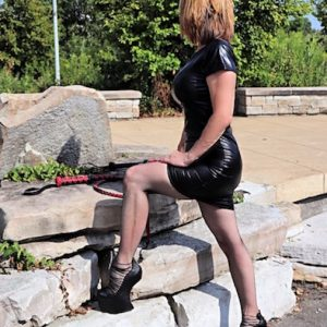 Black Latex Dominatrix in Detroit high heel platform shoes