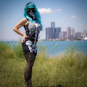 Detroit BDSM Mistress in blue wig and skeleton top