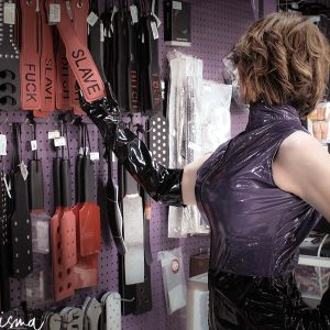 Detroit BDSM Slave Domme shopping for paddles