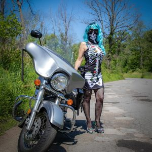 Domme Detroit Michigan blue wig next to motorcycle