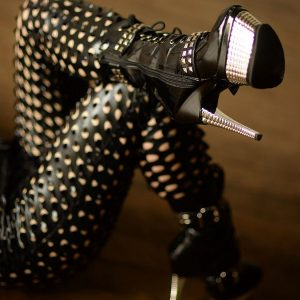 Kat Morgan Catsuit studded high heels legs crossed
