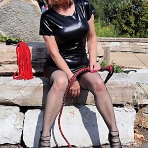 Latex Whipping Detroit Mistress with red and black whip